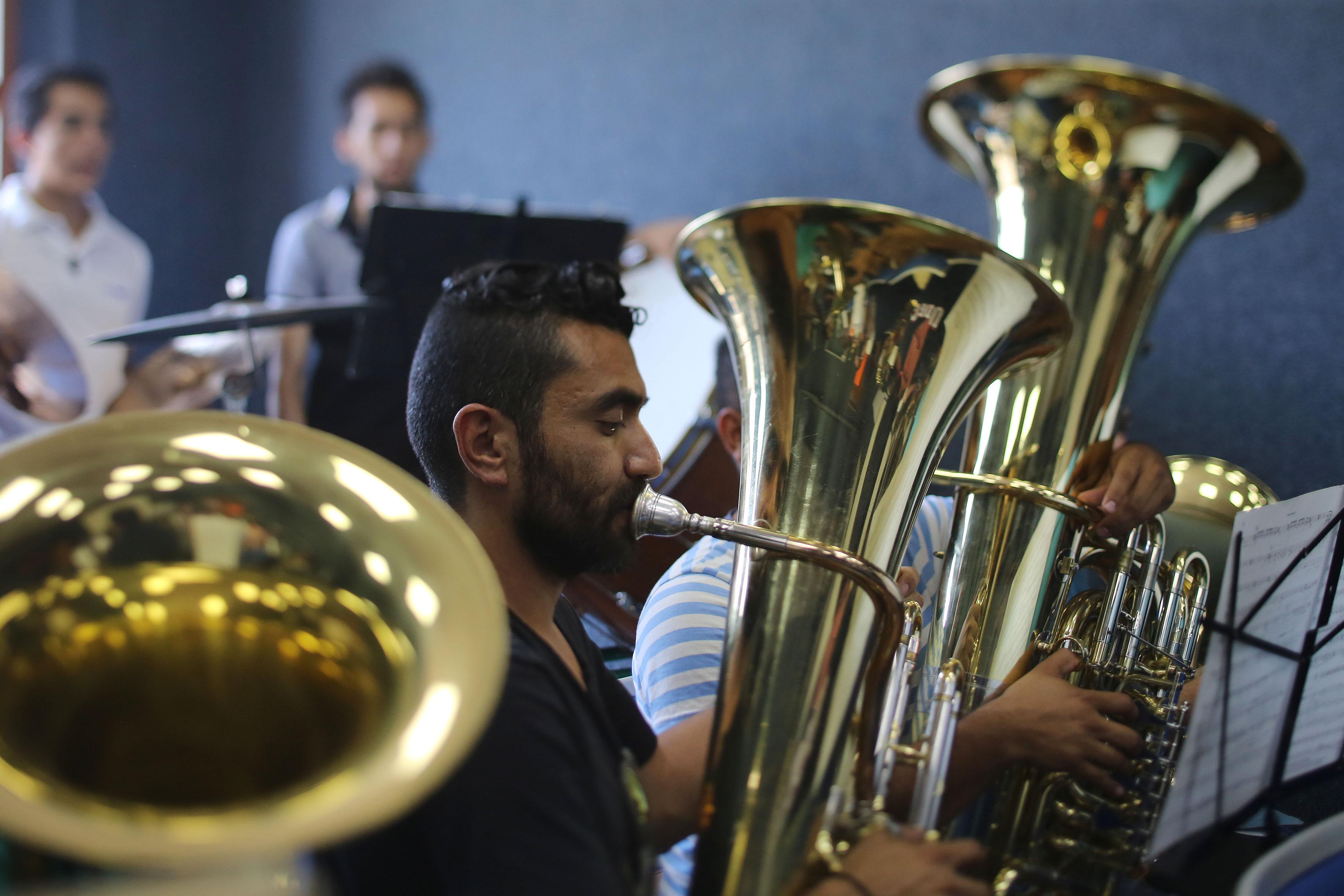 Banda sinfónica de la UdeG, realizando un ensayo.